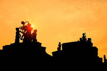 silhouette of a statue