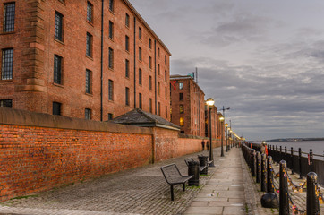 Cobbled Footpath Lined with Renovated Buildings at Twilight