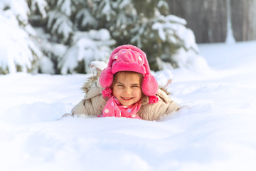 Little child playing in snow