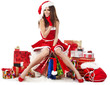 beautiful sexy girl wearing santa claus clothes with christmas g