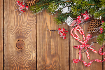 Christmas wooden background with decor and snow fir tree