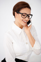 Businesswoman in glasses chatting on a mobile