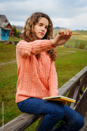 Young artist at mountain