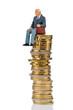 canvas print picture - Rentner sitzt auf Geldstapel