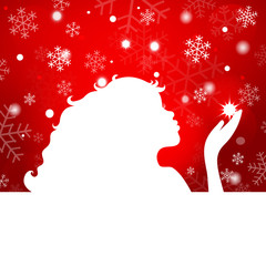 Silhouette of beautiful girl blowing snowflakes on a red backgro