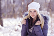 portrait of a young blonde girl in winter forest in the park