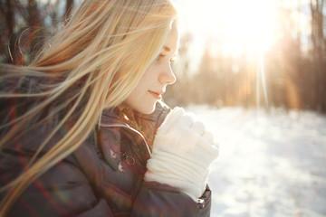 winter portrait of a cute blonde teen