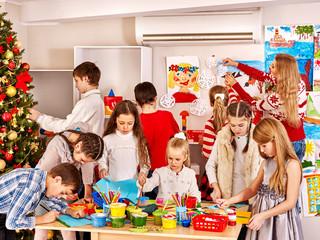 Children making card.