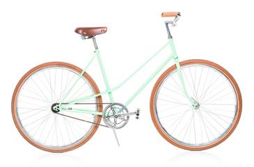 Stylish green female bike with brown wheels on white