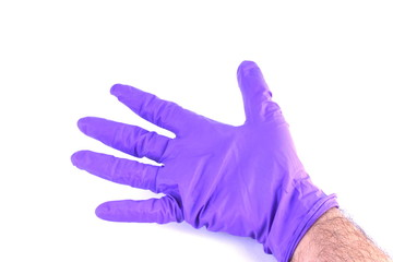 Hand wearing surgical glove