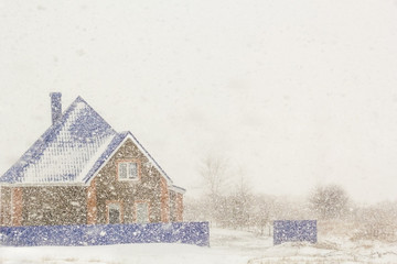 House on the background of plentiful snowfall