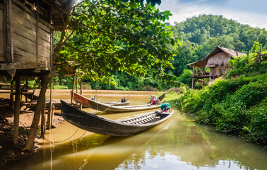 Long-tail boats moored in a village of stilt houses