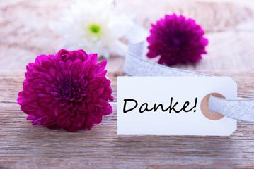 Schild mit Danke und lila Blüten