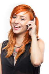 Red-haired young girl laugh on a smartphone