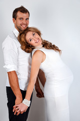 Happy Pregnant Couple on white background