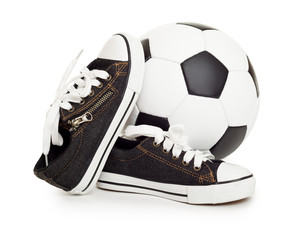 soccer ball and sport shoes on white