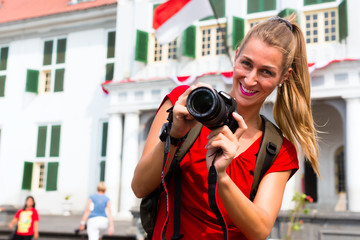 Tourist taking pictures in old batavia district ofjakarta