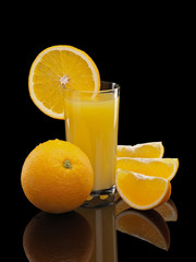 Glass of orange juice with fruit