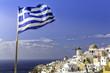 Village of Oia with Greek flag waving, Santorini Island