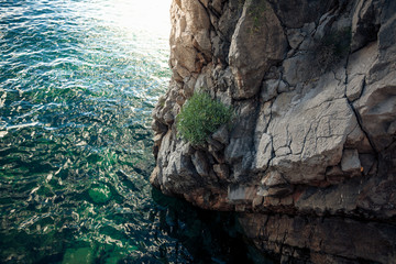 view of high cliff in deep blue sea
