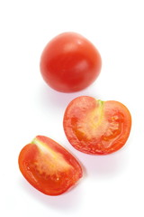 Fresh slice cherry tomato  isolated on a white background