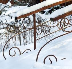 Railing of bridge in snow