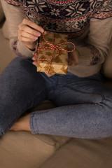 Woman opening Christmas gift