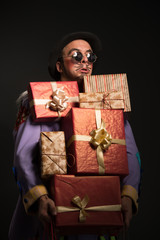 Man clown carrying Christmas gifts