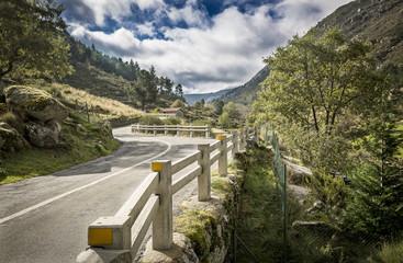 landscape with an asphalt road trough the mountain