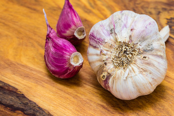 Organic garlic on wooden table background