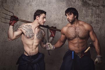 Two tattooed men