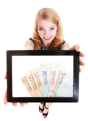 Girl showing euro money banknotes on tablet.