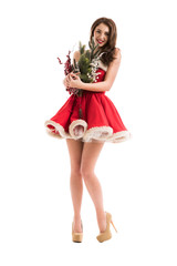 Woman in Santa Claus dress with Christmas decorations bouquet