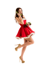 Beautiful happy woman in Santa Claus dress calling phone