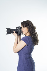 Young woman making a photograph