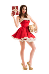 Woman in Santa Claus dress with gift boxes