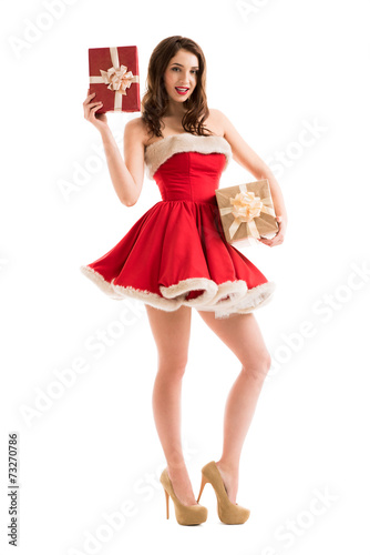 canvas print picture Woman in Santa Claus dress with gift boxes