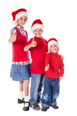 Three kids in Christmas hats