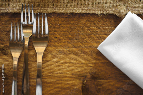 Forks on a table - 73272190