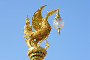 Golden swan lamp  on blue sky