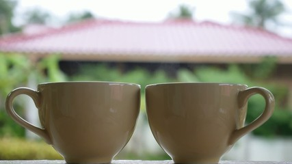 Two Hot Tea Cups with Steam in Garden in Summer Cottage.