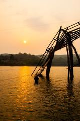 Sunset at wood bridge (Mon bridge) in Sangklaburi, Thailand