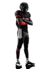american football player standing arms crossed silhouette