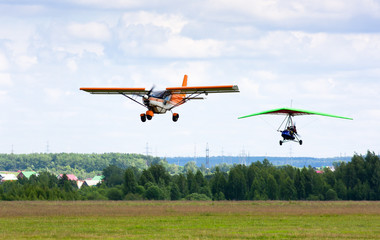 airplane and hang-glider