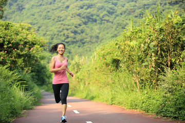 fitness woman runner running on trail
