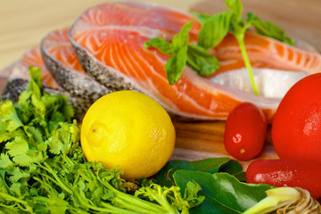Delicious  portion of fresh salmon fillet with lemon and basil