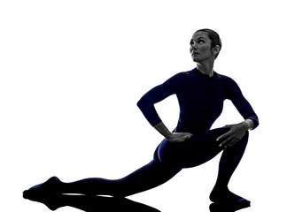 woman exercising Parivrrta Parsvakonasana Revolved Extended Side