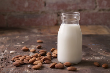 Almond milk in a glass jar with almonds