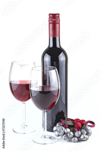 Fotobehang Bar Two red wine glasses and Christmas ornament isolated on white
