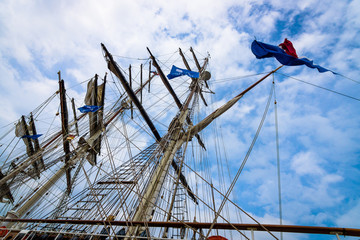 Detail of rigging of sailing ship against a blue sky.
